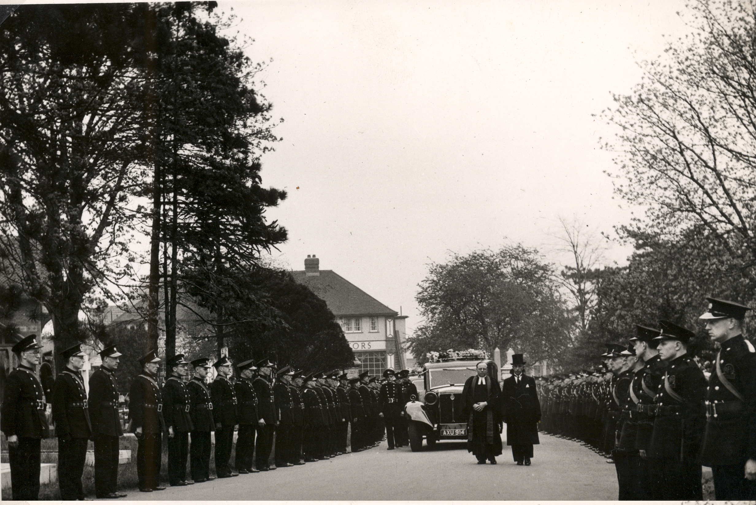 Funeral cortege at cemetery